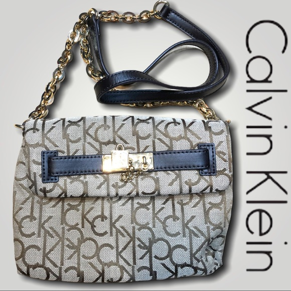 CK cross body with gold hardware & leather details